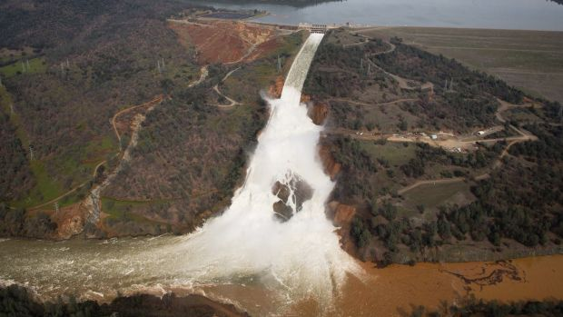 The emergency spillway, and the damaged main spillway, are seen from the air on Monday in Oroville, California. Photograph: Elijah Nouvelage/Getty
