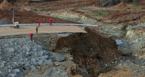 California water resources crews inspect  the erosion just below the Lake Oroville emergency spillway site after lake levels receded on Monday. Photograph: Kelly M Grow/ Reuters
