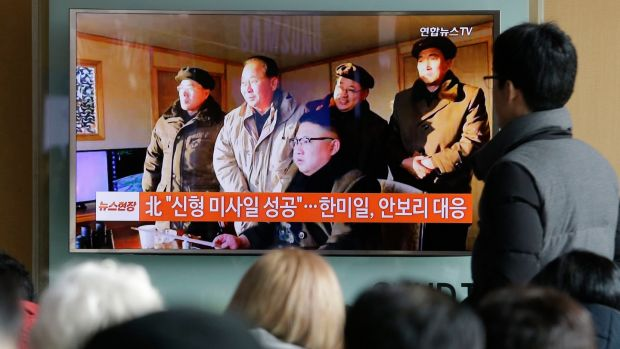 People in Seoul, South Korea watch a TV news programme showing North Korean leader Kim Jong Un. Photograph: Ahn Young-joon/AP