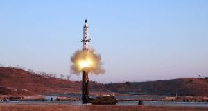 This photo taken on February 12th shows the launch of a surface-to-surface medium long-range ballistic missile Pukguksong-2 at an undisclosed location. Photograph: STR/Getty Images