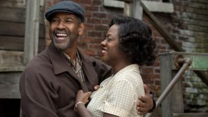 Dangerous charisma: Denzel Washington as Troy Maxson and Viola Davis as his long-suffering wife, Rose, in Fences.