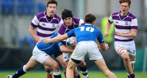 Clongowes' Sean McCrohan is tackled by St Mary's duo  Niall McEniff and Daragh McDonagh during the Leinster Schools Senior Cup clash at Donnybrook. Photograph: Gary Carr/Inpho