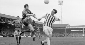 West Bromwich Albion centre-forward Jeff Astle  challenging for a high ball with Liverpool goalkeeper Tommy Lawrence in 1968. The brains of former footballers should be donated for research to allow studies into the health effects of heading the ball, the daughter of Mr Astle said.  Photograph: PA Wire
