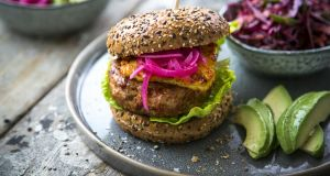 Chorizo chicken burgers with quick-pickle onions, haloumi and red cabbage and seed slaw