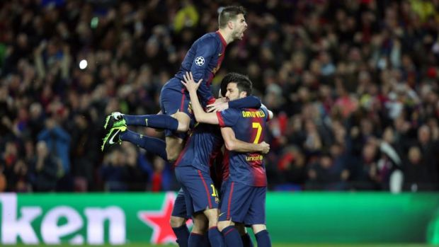 Barcelona players celebrate after Lionel Messi scored the opening goal. Photo: AOP.Press/Corbis via Getty Images