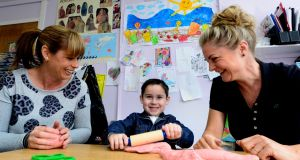 Luke McArdle with his mother Lynn, left, and  pre-school co-manager Margaret Hennessy at  Beaumont Community Pre-school. Photograph: Cyril Byrne