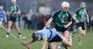 LIT's David Reidy competes for possession with Jack O'Connor of UCD. Photograph: Morgan Treacy/Inpho