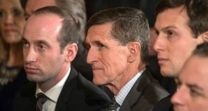 Former national security adviser Michael Flynn, centre: Gen Flynn was dismissed by President Donald Trump on Monday. Photograph: Stephen Crowley/The New York Times