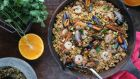 Cauli rice topped with mussels and prawns and fragrant cinnamon