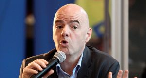 Gianni Infantino answers questions  in Doha, Qatar, on Thursday. Photograph: Naseem Zeitoon/Reuters