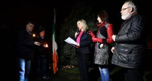 Sinn Féin's leader in Northern Ireland Michelle O'Neill addresses attendees at a vigil in Clonoe in Co Tyrone. Photograph: Getty