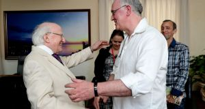 President Michael D Higgins(left)  greets author Joseph O'Connor in Havana as part of a three-day State visit to Cuba. Photograph: Maxwells