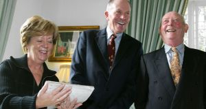 John McGahern, right, after he handed over his literary archive to NUI Galway in 2003,  with Dr Iognaid O Muircheartaigh, President of the College, and  librarian Marie Reddan. Photograph: Joe O'Shaughnessy