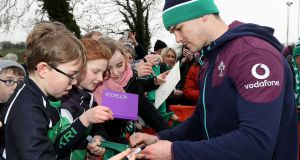 Johnny Sexton signs autographs for fans at Friday's open training session at Monaghan RFC. Photograph: Dan Sheridan/Inpho