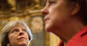 Theresa May and Angela Merkel: whatever happens in public, the real action will be between Merkel and Wolfgang Schäuble on one side and May, Boris Johnson, David Davis and Liam Fox on the other. Photograph: Leon Neal-Pool/Getty