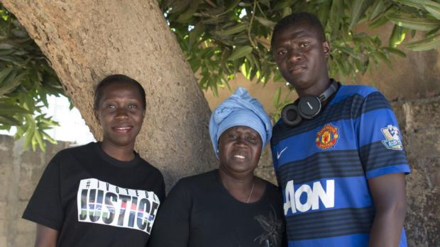 Isatou Jammeh, Fatimah Jaiteh and Ebrima Jammeh, estranged relatives of Gambia's former dictator Yahya Jammeh, in Serrekunda. Photograph: Lorraine Mallinder