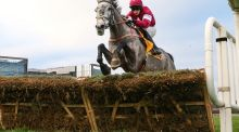 Bryan Cooper and Petit Mouchoir clear the last fence to win the Ryanair Hurdle at the Leopardstown Christmas Festival. Photograph: INPHO/James Crombie