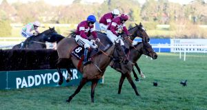 Outlander (nearest camera) clears the last on the way to winning the Lexus Chase at Leopardstown at Christmas. Don Poli (jockey with white helmet) is also pictured. Photograph:  Donall Farmer/Inpho
