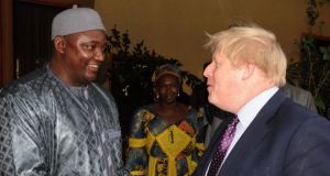 Gambia's new president Adama Barrow meeting Britain's foreign secretary, Boris Johnson on Tuesday in Banjul. Photograph: Kuku Marong/AP