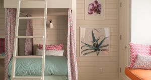 Architect Pamela Sandler worked with interior designer Elena Letteron of Germain Interiors to create this fairytale arrangement in a lakeside summer home. The beds stand taller than bunk beds you might buy from a furniture shop and were designed to take advantage of the extra ceiling height, so that climbing to the top bunk feels like a real retreat. Painted in Benjamin Moore Dove White, Letteron also used the additional headroom to give each bunk its own reading light.  sandleraia.com germaininteriors.com
