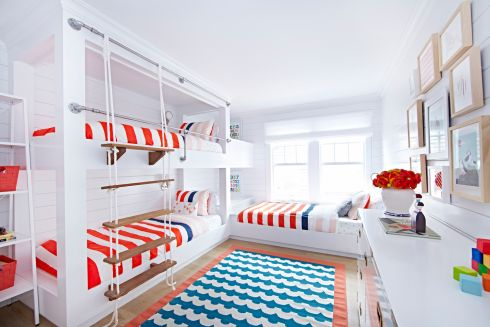 This is a fresh take on the nautical theme for a Jersey shore bungalow. Designed by New York-based interiors firm Chango & Co it features a shipshape configuration of two bunks, accessed by a rope ladder that wouldn't look out of place on a sailing vessel and it is secured with maritime-grade steel railings. A third built-in bed sits at right angles so all three occupants can see each other. The only navy in the room is a trim on the wide red and white striped bed linen.   Photograph: Jacob Snavely  change.co              1 This is a fresh take on the nautical theme for a Jersey shore bungalow. Designed by New York-based interiors firm Chango & Co it features a shipshape configuration of two bunks, accessed by a rope ladder that wouldn't look out of place on a sailing vessel and it is secured with maritime-grade steel railings. A third built-in bed sits at right angles so all three occupants can see each other. The only navy in the room is a trim on the wide red and white striped bed linen.   Photograph: Jacob Snavely  change.co