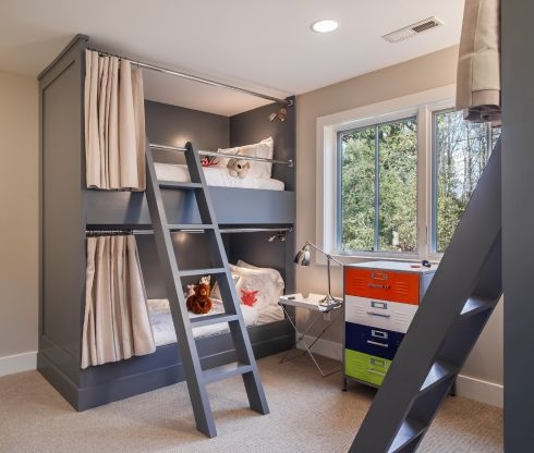 "The owners of this weekend house wanted their kids to experience ""country"" living and to be able to share this experience with friends, hence the bunkroom idea, explains builder Jonathan Caron. ""Ceiling height was a consideration. The owner wanted to allow enough space for each bunker to be able to sit up without hitting their head."" Privacy curtains, individual reading lights and ladders strong enough for an adult to use were other factors.   jonathancaron.com"
