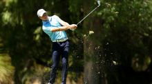 Brett Rumford of Australia plays his second shot during round three at Lake Karrinyup Country Club in Perth. Photograph: Getty Images