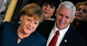 German chancellor Angela Merkel (left) and US vice president Mike Pence arrive at the 53rd Munich Security Conference (MSC) in Munich, Germany, on Saturday. Photograph: EPA