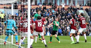 Lincoln City's Sean Raggett scores his side's winning goal in the FA Cup fifth-round match against Burnley at Turf Moor. Photograph: Martin Rickett/PA Wire