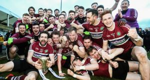 St Mary's celebrate after their Sigerson Cup final victory. Photograph: Tommy Dickson/Inpho