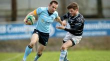 Garryowen's Ronan O'Halloran tries to avoid the attempted tackle of UCD's  Tom Fletcher during the Ulster Bank League Division 1A match at  Dooradoyle in Limerick. Photograph: Ryan Byrne/Inpho