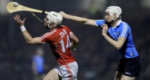 Dublin's Liam Rushe nips in to claim the sliotar ahead of Cork's patrick Horgan during the Allianz Hurling League Division 1A match at Páirc Uí Rinn. Photograph: Donall Farmer/Inpho