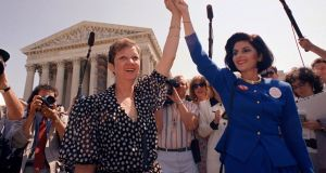 In this April 26, 1989 file photograph, Norma McCorvey, Jane Roe in the 1973 court case, (L), and her lawyer  Gloria Allred hold hands as they leave the Supreme Court building in Washington after sitting in while the court listened to arguments in a Missouri abortion case. Photograph: AP