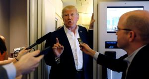 US president Donald Trump speaks with reporters aboard Air Force One on his way to a rally  in Melbourne, Florida, on Saturday. Photograph: Reuters