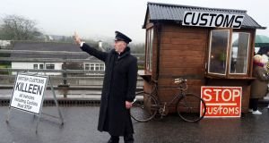 Demonstrators dressed as custom officials man a mock customs checkpoint at the Border crossing in Killeen, near Dundalk, Co Louth on Saturday. Photograph: Paul Faith/AFP/Getty Images