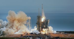 The SpaceX Falcon rocket launches from the Kennedy Space Center in Florida on Sunday carrying a load of supplies for the International Space Station. Photograph: Red Huber/Orlando Sentinel via AP