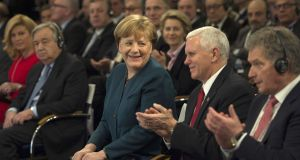 "German chancellor Angela Merkel and  Mike Pence at the Munich conference, where the US vice president  pledged ""unwavering"" support for Nato. Photograph: Guido Bergmann /Bundesregierung via Getty Images"