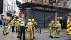 Members of Dublin Fire Brigade attend Weir and Sons on Grafton Street on Sunday. Photograph: Chris Dooley