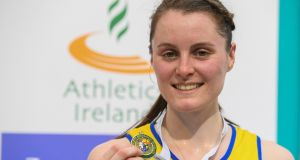 Ciara Mageean of UCD AC with her gold medal after winning the 3000m at the National Senior Indoor Championships at the National Indoor Arena, Abbotstown. Photograph: Brendan Moran/Sportsfile.