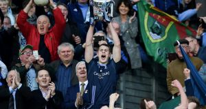 St Patrick's Westport's Brian McDermott lifts the cup after his side's victory in the All-Ireland intermediate club final. Photograph: Tommy Grealy/Inpho