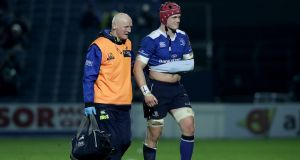 Josh van der Flier leaves the field  during Leinster's game with Edinburgh on Friday. His shoulder injury is expected to keep him out of the rest of the Six Nations. Photograph: Morgan Treacy/Inpho