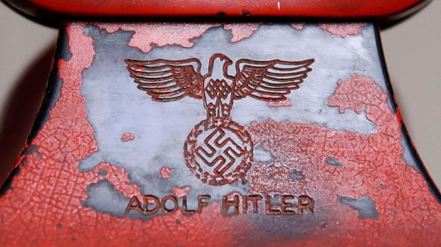 An engraving of a swastika and Adolf Hitler's name are seen on the back of Hitler's personal travelling telephone. Photograph: Patrick Semansky/AP