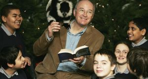 Philip Pullman at an exhibition at London Zoo in 2004 based on the His Dark Materials trilogy, with Dana, a lemur, and young fams. Photograph: MJ Kim/Getty Images