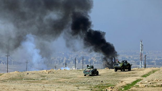 Smoke rises during a battle between Iraqi forces and Islamic State militants south of Mosul, Iraq. Photograph: Alaa Al-Marjani/Reuters