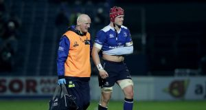 Leinster's Josh van der Flier leaves the field with an injury against Edinburgh. Photograph: Morgan Treacy/Inpho