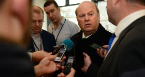 Minister for Finance Michael Noonan: appointed Seamus Coffey  to look into the tax code. Photograph: Dara Mac Dónaill