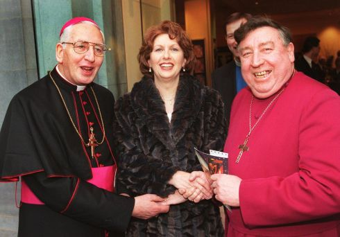 Then-president Mary McAleese exchanges seasonal greetings with Church of Ireland Archbishop of Dublin Dr Walton Empey (right) and  Catholic Archbishop of Dublin Dr Desmond Connell at an ecumenical celebration in the National Concert Hall
