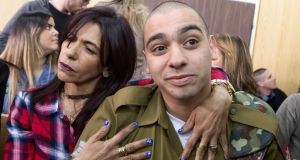 Israeli soldier Elor Azaria is embraced by his mother at the start of his sentencing hearing in a military court in Tel Aviv. Photograph: Jim Hollander/EPA