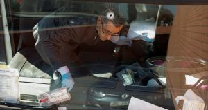 An investigator  examines inside the gas cylinder delivery truck. Photograph:  Albert Gea/Reuters