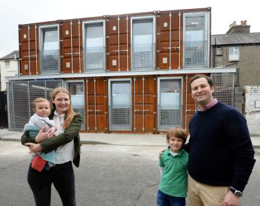 Self-contained: Maggie and Gordon and Kelley with their children Gordie (7) and Penny Bell (8 months) at their house built from shipping containers in Ringsend, Dublin. Photograph: Eric Luke